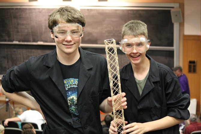 Steamboat Springs High School Science Olympiads Ty Coghlan, left, and Taylor Zabel show off the tower they built for a state competition in Golden.