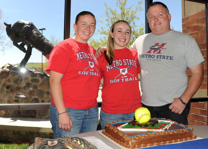 Soroco senior Brandi Roundtree, center, celebrates her decision to play softball at Metro State with her sister, Amber Roundtree, and father, Lenny Roundtree, on Friday at Soroco High School.