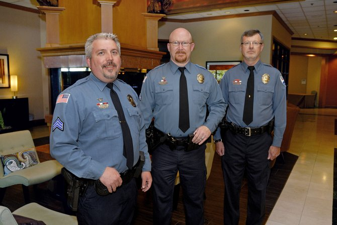 Craig Police Department members, from left, Sergeant Corey Wagner, Officer Mike Edwards and Officer Lance Eldridge were named Officers of the Year by the Colorado Law Enforcement Officers Association Friday for pulling a Craig resident from his burning house in February. The man, Patrick Hunter, later died from injuries sustained in the fire, but Hunter's children both said the officers were deserving recipients.
