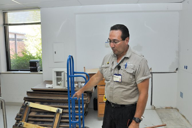 John Martinez, a Tech 3 with The Memorial Hospital's maintenance department, explains the ongoing remodel at TMH Medical Clinic on Friday morning. Crews are transforming portions of the clinic, which once housed the hospital, into a new pediatric unit.