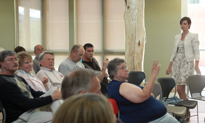 North Routt resident and candidate forum organizer BJ Vale raises her hand on Saturday at the North Routt Candidate Forum to ask a question of Jessica Garrow, a candidate for 3rd Congressional District CU regent.