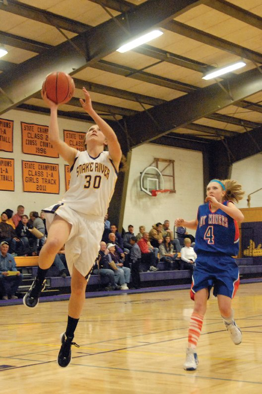 Morgan Wille, a Little Snake River Valley (Wyo.) School senior, puts up a lay-up during a January 2012 game against Hanna-Elk Mountain in Baggs, Wyo. Wille will represent Baggs in multiple basketball tournaments over the summer, including the Wyoming vs. Montana All-Star event. She will also be playing basketball as a freshman for Sheridan College.