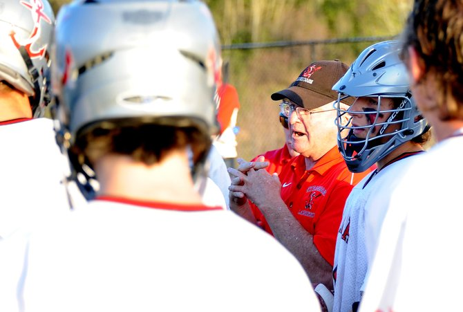 Steamboat boys lacrosse coach Bob Hiester talks with his team in the waning moments of Saturdays 9-4 playoff victory against Denver East. The team will travel to face Kent Denver next, playing Wednesday.