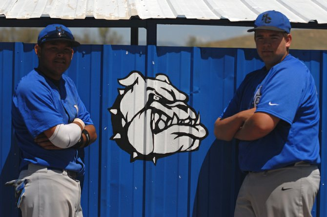 Moffat County High School seniors Carlos Maldonado, left, and Ivan Nielsen take a break between games Saturday behind the home dugout at Craig Middle School. The two upperclassmen of the MCHS varsity baseball team finished their high school careers with a doubleheader against Glenwood Springs.