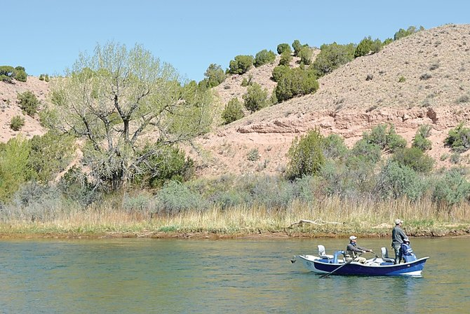 A fishing party floats the Green River on Sunday morning below Indian Crossing in Utah, just west of Browns Park.