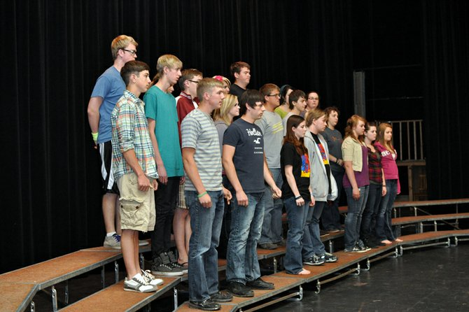 "Moffat County High School choir students pause Monday as they take direction from theater and choir teacher Heather Dahlberg, not shown, during a rehearsal in the high school auditorium. Craig Middle School choir students will join MCHS singers onstage at 7 p.m. Tuesday for ""I've Got the Music In Me,"" the final choir concert of the school year."