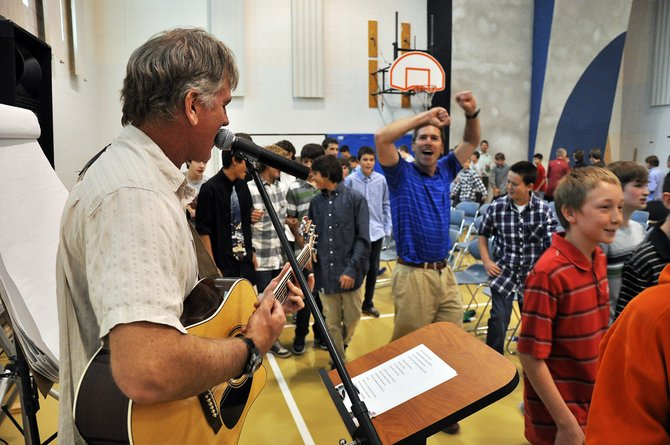 Todd Musselman sings and plays guitar as eighth-grade students and teachers dance Tuesday at Colorado Mountain College's Alpine Campus. The students attended a number of workshops meant to prepare them for the transition to high school.