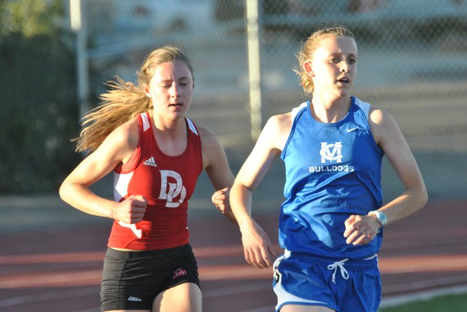 Moffat County High School junior Eryn Leonard paces herself in the 3200-meter run at the Tiger Invitational Saturday in Grand Junction. Leonard placed second in the event, as well as 10th in the 1600-meter run. The MCHS girls placed 14th overall in the weekend meet.