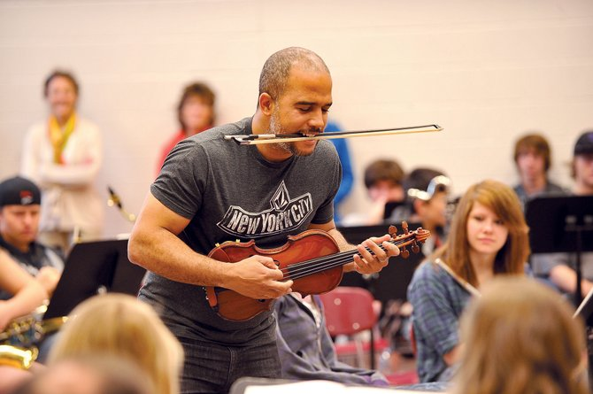 Daniel Bernard Roumain, a classically trained composer, performer and violinist, takes an unconventional approach to playing the violin Tuesday while playing for students at Steamboat Springs High School. He will perform Friday at Strings Music Pavilion and is the featured artist for the 2012-13 Strings School Days outreach program.