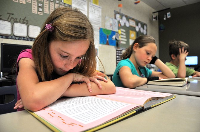 Morgan Graham, a third-grader at Soda Creek Elementary School, reads Wednesday afternoon during class. Steamboats third-graders posted record scores on this years state reading test.