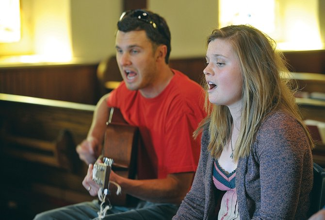 Singer Katie Ross and Henry Howard, youth director at St. Paul's Episcopal Church, perform a song during a jam session Thursday evening at the church. The creative incubator of the weekly Jam Sesh, a youth group at St. Paul's Episcopal Church, has cultivated the musical and songwriting talents of about seven regular attendees.