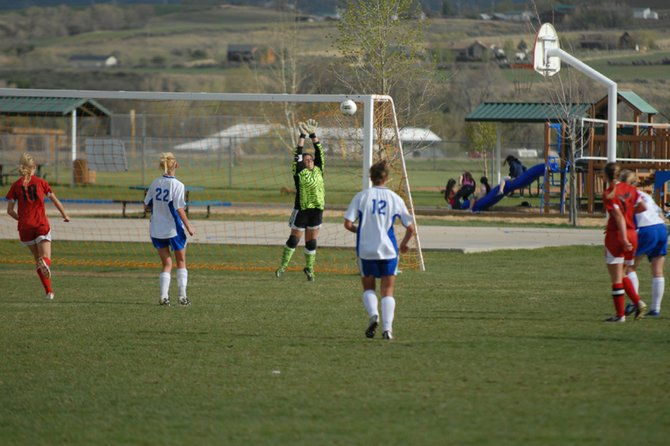 Moffat County High School junior Skylar Tripp deflects a shot from the outer edge during the MCHS girls varsity soccer team's home game against Glenwood Springs this season. Tripp is one of several juniors returning as seniors to the team next season.