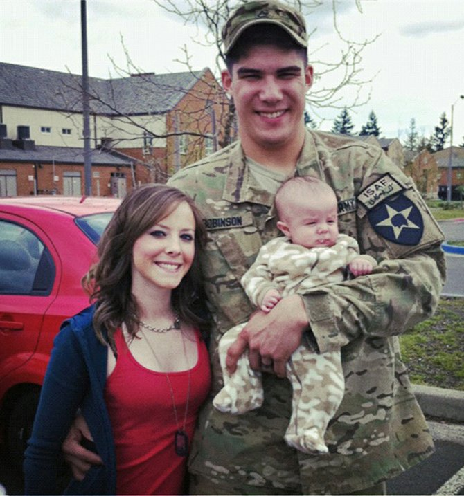 Pfc. Ethan Robinson poses with his wife, Dani, and newborn son, Jace. Robinson, who was born and raised in Craig, is currently serving with the U.S. Army's Second Stryker Brigade of the Second Infantry Division in Kandahar, Afghanistan. He was deployed April 28.