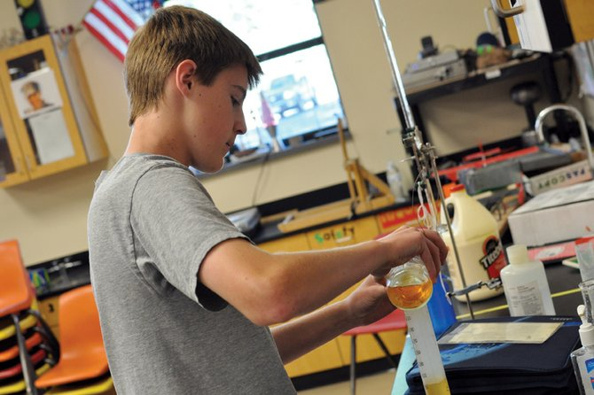 Connor Knez, 14, a student in Craig Middle School's River Watch program, tests oxygen levels in a water sample from Fortification Creek on Tuesday morning in Norm Yoast's classroom at the school. Yoast's students have consistently provided reliable data to state agencies charged with maintaining water standards, said Barb Horn, a Colorado Parks and Wildlife water resource specialist.