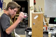"Spencer Turner, 14, examines a sample he tests for water hardness Tuesday morning at Craig Middle School. Turner signed up for the school's River Watch program ""just because it's fun,"" he said. ""You get to get out of school and get to help check the rivers."""