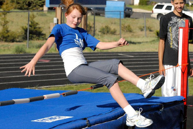 Rylie Anderson, 10, leaps over the high jump bar during Monday's Moffat County Youth Track Meet at the Moffat County High School track. More than 120 local children participated in the event designed to give younger kids an impression of track and field before middle school and high school.