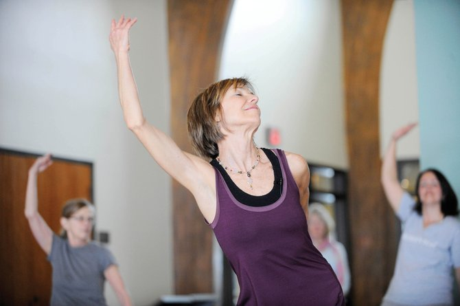 Patty Zimmer leads a Yogatta Dance class during Yoga Day 2011 at Bud Werner Memorial Library. This years Yoga Day celebration takes place Sunday with donation-based sample classes all day and a raffle.