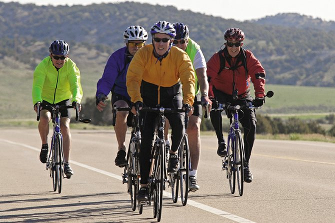"Cyclists from Steamboat Springs pedal on the highway coming from Craig during the 25th annual ""Where the Hell's Maybell?"" biking event in 2011. This year's event is scheduled for Saturday. The ride is free and participants can embark from one of two locations at 7 or 7:30 a.m."