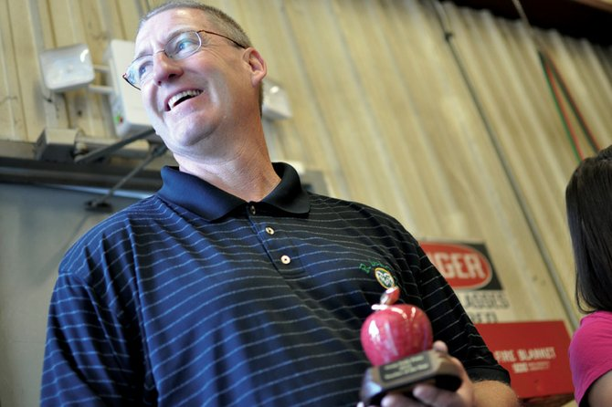 John Haddan, a Moffat County High School agriculture education instructor, smiles Thursday morning after receiving the 2012 Teacher of the Year award from the Craig Daily Press. Haddan has taught at MCHS for about 15 years.