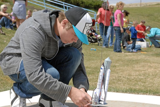 "Moffat County High School student Levi Ogden primes the ignition system on his model rocket during Friday's ""Rockin' Rockets"" competition sponsored by the MCHS science department. Ogden received awards for most creative design and epic disaster."