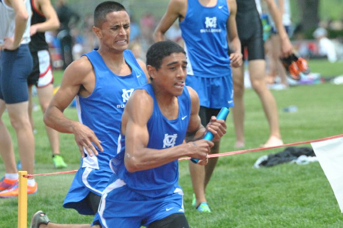 Moffat County High School senior Alfredo Lebron takes the baton from senior Miguel Molina in the 4-by-800-meter relay Thursday at the 4A state track and field championships. Besides being part of the winning relay team, Lebron won the 800-meter run Friday morning with a time of one minute, 55.01 seconds. Lebron, Molina, senior Johnny Landa and junior Erik Silva-Tarango also competed in the 4-by-400-meter relay Friday, placing 13th.