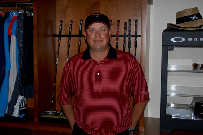 Club pro Jason Back displays the selection of putters on sale in the pro shop at Yampa Valley Golf Course. Back, 34, has played the sport since he was 11 and considers his job a dream come true.