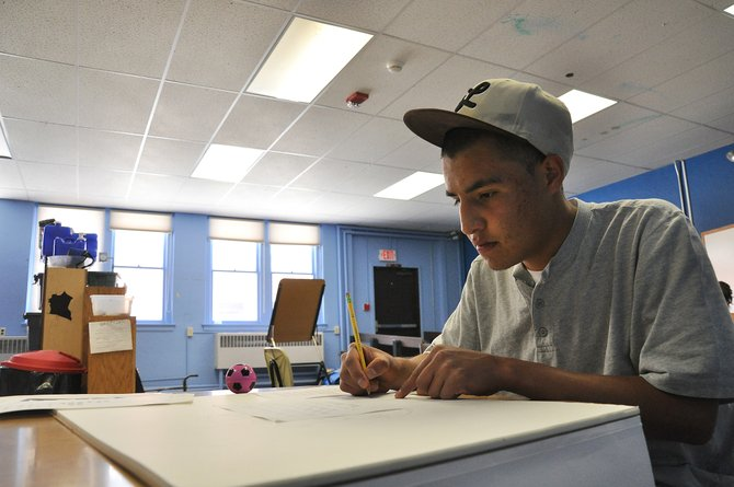 Yampa Valley High School senior Carlos Miranada works on an art project Monday. The Steamboat Springs School Board on Monday night approved a renovation project that will add a science lab, front reception desk, lockers and private offices to the high school for the first time.