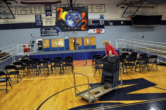 Dixie Hatfield, Moffat County High School head custodian, sets up chairs Monday morning in the MCHS gym in preparation for graduation ceremonies, which take place at 10 a.m. Saturday. Other events are scheduled this week at the high school, including an awards ceremony Tuesday and a baccalaureate ceremony Wednesday. Both events take place at 7 p.m. in the MCHS auditorium, 900 Finley Lane.
