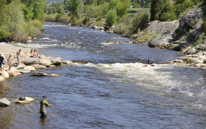 People recreate Tuesday at the Yampa River near Charlies Hole, which will be the headquarters for this weekends Yampa River Festival.