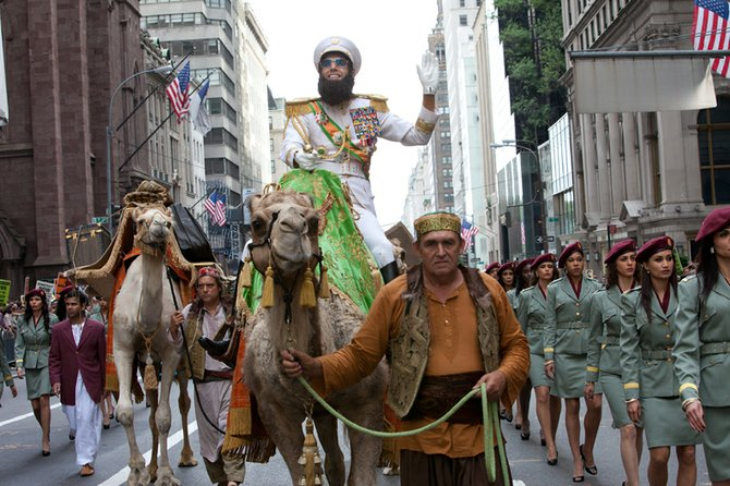 "Admiral General Hafez Aladeen (Sacha Baron Cohen) and his entourage block traffic on a busy New York street on the way to the United Nations in ""The Dictator."" The movie, from the creators of ""Borat"" and ""Brüno,"" is about an egocentric despot of a North African country who is forced to live in poverty when his position is usurped during a trip to America."