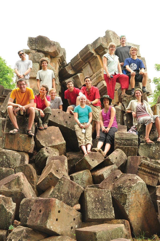 The Lowell Whiteman School students pose for a photo at the remains of an ancient temple near Battambang, Cambodia.