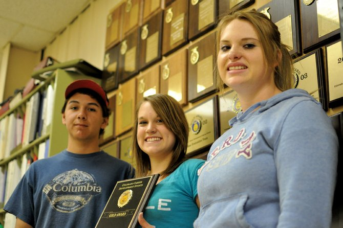 From left, Brady Martinez, Emily Wellman and Makayla Goodnow, members of the Moffat County High School Future Farmers of America meat judging team, pose for a photo Tuesday at the high school's agricultural shop. Their team, which included MCHS junior Tyler Hildebrandt, took the state title in meat judging during an FFA event April 30 in Fort Collins.