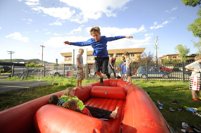 "Cole Gedeon, 10, of Steamboat Springs, plays on a raft during the Yampa River Festival registration party Friday at Backdoor Sports. Find a complete Yampa River Festival schedule <a href=""http://www.steamboattoday.com/news/2012/may/22/yampa-river-festival-be-held-during-holiday-weeken/"">here</a>. The National Weather Service is forecasting a high of 77 degrees Saturday with winds as fast as 70 mph."
