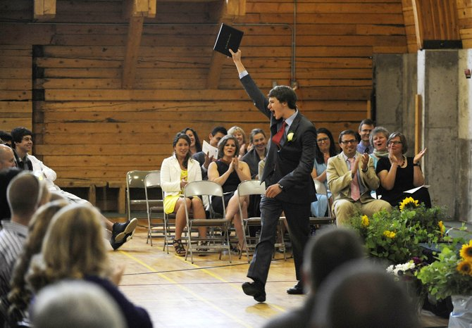 Alex Rudolph celebrates after receiving his diploma Saturday at The Lowell Whiteman School.