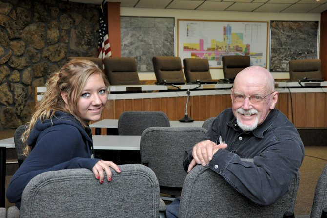 "Kaylee Buckley, a Craig Middle School eighth-grader, poses for a photo Wednesday in the Craig City Council chambers with Mayor Terry Carwile. Kaylee is one of four state winners of the Colorado Municipal League's ""If I Were Mayor"" essay contest."