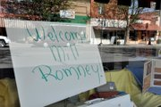 A sign welcoming Republican presidential candidate Mitt Romney sits Friday inside Pam Design Interiors at 512 Yampa Ave.