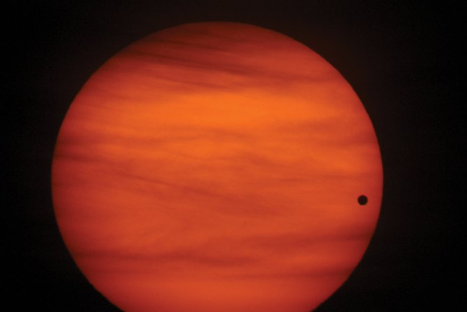 The Venus transit of June 8, 2004, shown here, was the first in the current pair of transits, but it was visible only from the eastern U.S. Next week's transit will be the last one until 2117 and will be seen from coast to coast. Be sure to practice safe solar observing with a proper filter or telescope projection technique to view the small black ball of Venus as it drifts across the sun.