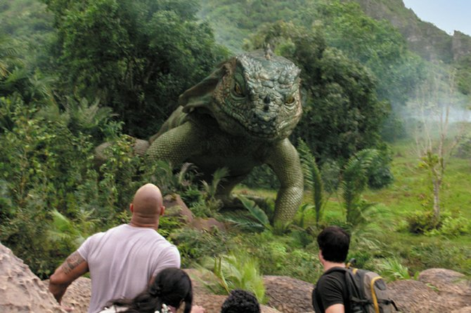"Adventurers Hank and Sean (Dwayne Johnson, Josh Hutcherson) encounter a giant lizard in ""Journey 2: The Mysterious Island."" The movie is loosely based on the works of Jules Verne about a tropical location with fantastic animals and natural features."