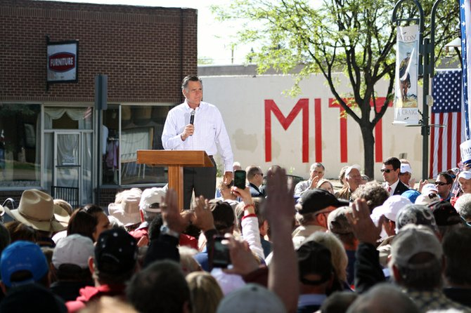 Mitt Romney addresses the crowd Tuesday at a rally in Craig. Brita Horn, a Republican candidate for the Routt County Board of Commissioners who attended the event, said, &quot;There seemed to be a real buzz among the base.&quot;
