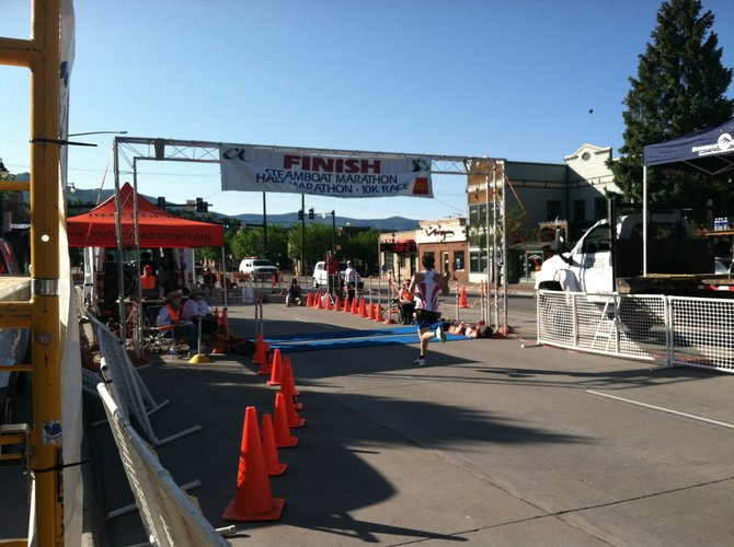 Matt Davies crosses the line first in the Steamboat Marathon 10K.