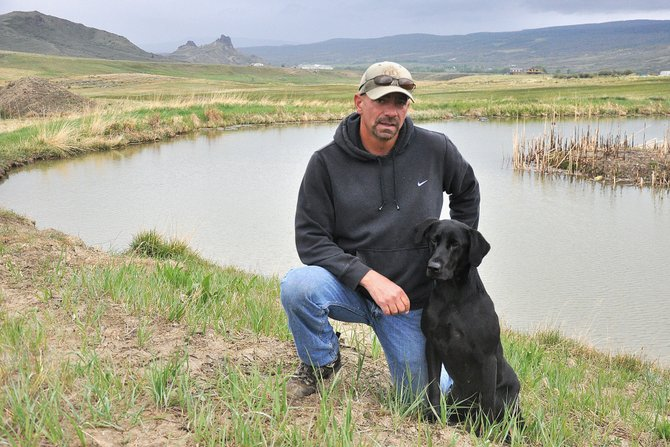 Joel Harris and Marti, his black Labrador retriever, will travel from Yampa to Onaway, Mich., later this month to compete in the 2012 National Amateur Retriever Championship.