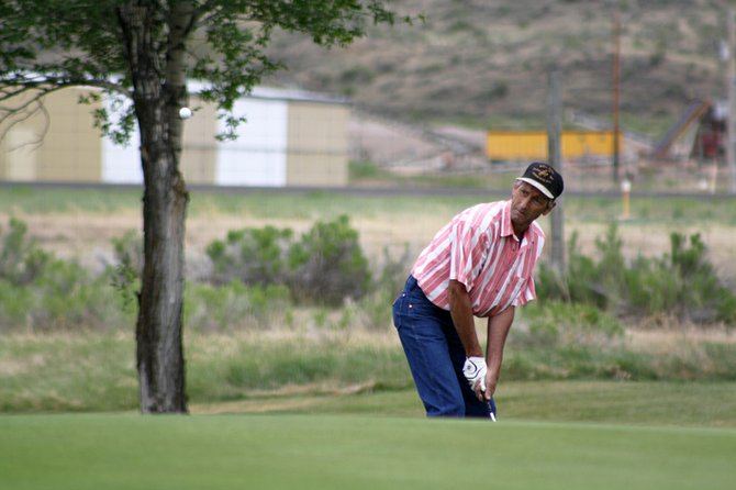 Rich Behrman chips to the green Saturday at Yampa Valley Golf Course during a tournament. The course also hosted a tournament Friday. Club pro Jason Back said this month will be the busiest of the summer at the golf course.