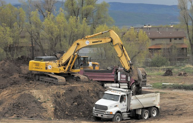 Crews from Native Excavating work on building the new senior living center near Casey's Pond in Steamboat Springs earlier this year. The $21 million building permit valuation of the new Casey's Pond Senior Living community has made a substantial difference in local construction dollar volume.