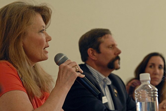 Colorado Senate District 8 incumbent Jean White, R-Hayden, current Colorado House District 57 Rep. Randy Baumgardner, R-Hot Sulphur Springs, and Libertarian candidate Sacha Weis address local voters Thursday night during a debate sponsored by the Bears Ears Tea Party Patriots at The Center of Craig, 601 Yampa Ave.