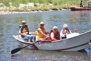 Dave Pike, second from left, pilots a boat Thursday on the Yampa River during a trip for local senior citizens. Hosting these and other activities for Craig residents is one of the more rewarding aspects of his job as Craig Parks and Recreation director, he said.