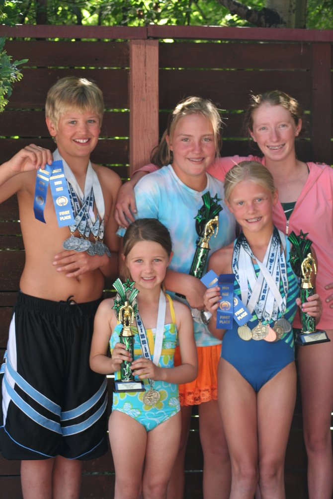 Members of the Steamboat Springs Swim Team display their awards after two recent competitions. Pictured in back, from left, are Jack Strotbeck, Maggie Morton and Samantha Terranova. In front, from left, are Grace O'Reilly and Jenna Smith.