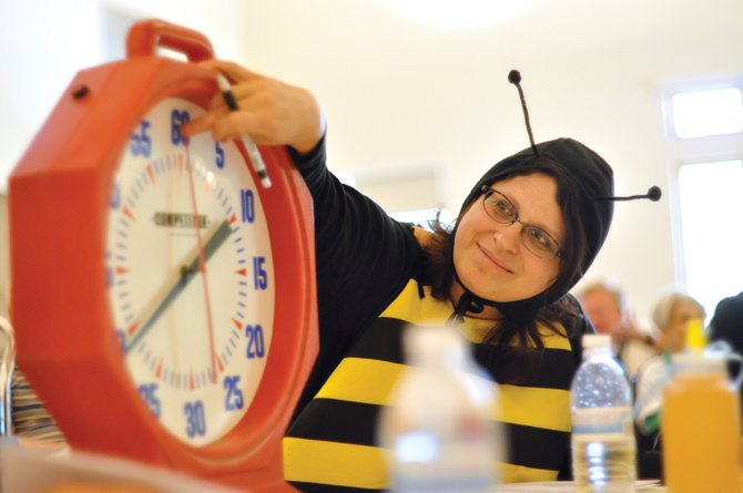 Bud Werner Memorial Library employee Mical Hutson prepares to start the clock Saturday during the preliminary rounds of the Community Spelling Bee. 3 No Trump took home top honors again in the second year of the competition.