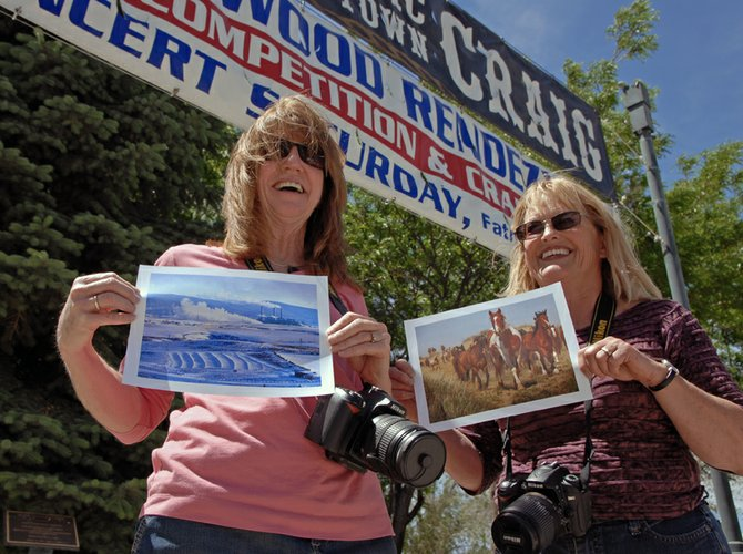"Local residents Janele Husband, left, and Kathy Simpson pose in downtown Craig with copies of their original photographs currently on display at the Colorado State Capital as part of an ""Our Town, Colorado"" exhibit. Husband and Simpson have nine photos on display in Denver out of a total of 70 taken by 27 artists representing 11 Colorado communities."