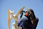 Bongo Love, a wood carver from Lafayette, puts the fine touches on his sculpture Friday for the 13th annual Whittle the Wood Rendezvous at Loudy-Simpson Park. Winners in the carving competition will be announced at 5 p.m. today.