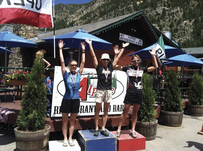 Tammy Jacques, center, and Amy Charity, right, celebrate Sunday after finishing the 2012 Guanella Hill Climb. Jacques was first, and Charity was second.